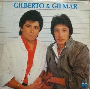 DE E X COM GILMAR ASSINO GILBERTO MUSICA BAIXAR A